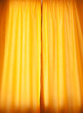 Yellow curtain as background. And texture Royalty Free Stock Images