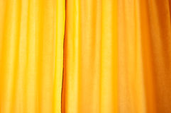 Yellow curtain as background Royalty Free Stock Photos