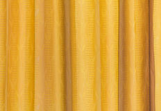 Yellow curtain fabric texture for background Stock Photography