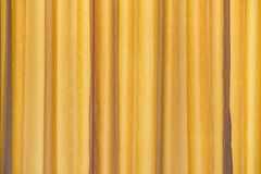 yellow curtain fabric texture for background Royalty Free Stock Images
