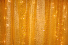 Yellow curtain with lights in the back Stock Photos