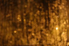 A yellow curtain of lights. In blur Royalty Free Stock Image
