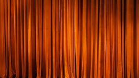 The yellow curtain. Theatrical scenes with light from the spotlights in the closed position royalty free stock photo