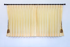 Yellow curtain was closed. Background of yellow curtain was closed, which hung on the wall bars stainless white gracefully Royalty Free Stock Photography