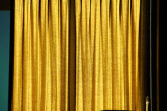 Yellow curtain on window. Background concept Stock Photos