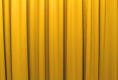 Yellow curtains shading the sun Royalty Free Stock Image