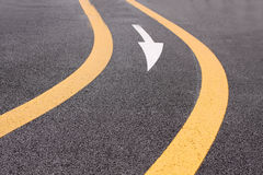 Yellow curve with arrow symbol. In an empty track and field stadium in Tokyo, Japan royalty free stock images