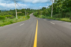 Yellow curve line on the road. Toward the mountain stock images