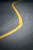 Yellow curve line on road. Yellow curve line on dark road for background stock photography