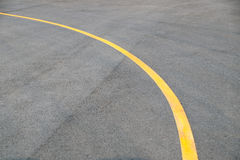 Yellow curve Traffic line on road floor texture and background stock photos