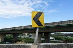 Yellow curve warning sign on side of express high way royalty free stock photography