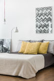 Yellow cushions on marriage bed Royalty Free Stock Image