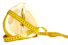 Yellow cutted fresh raw pomelo with measure tape around stock photography