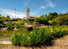 Yellow daffodils in city park with train depot Boise. Summer day at a Boise city park with flag and depot Royalty Free Stock Photography
