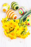 Yellow daffodils with easter eggs Royalty Free Stock Photography