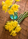 Yellow dafodills on wooden table Stock Photo