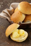 Yellow dairy butter on a fresh bun bread Royalty Free Stock Image