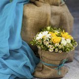 Yellow Daisies and Yellow Roses Bouquet stock photo
