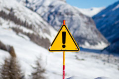 Yellow Danger Sign on Snowy Mountain Stock Images
