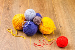 Yellow, dark blue, lilac, brown and red yarn Stock Images