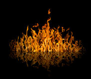 Yellow dark large flame with reflection on black Stock Photos