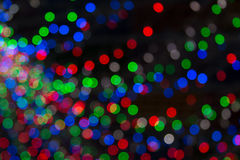 Yellow, dark, red, blue background. Christmas lights in bokeh. Boken. Stock Image