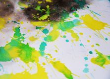 Yellow dark waxy watercolor paint abstract background, abstract background. Yellow, green and dark spots, vivid shapes and forms, abstract smooth background and Stock Photos