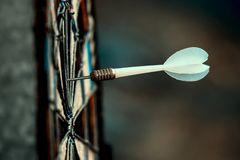 Yellow dart arrow hitting in the target of dartboard business success ideas concept royalty free stock image