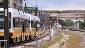 Yellow DART train in Dallas, USA stock footage