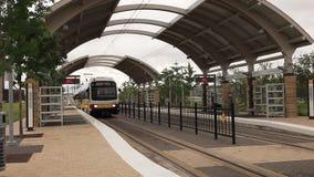 Yellow DART train in Dallas, USA stock video footage