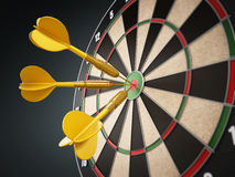 Yellow darts at the center of the target Stock Images