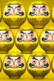 Yellow Daruma Dolls On Yellow Royalty Free Stock Image