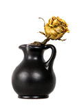 Yellow dead rose in black vase stock photography