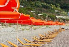 Yellow deckchair. On a beach Royalty Free Stock Photo