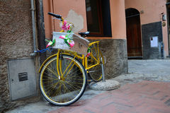 Yellow decorated bicycle Stock Photography