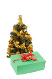 Yellow decorated christmas tree  and gift with red ribbon Royalty Free Stock Photo