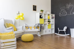 Yellow decorations in baby room Stock Photos