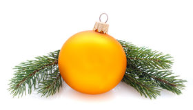 Yellow decorations ball and fir branches isolated Stock Photography