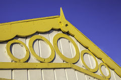 Yellow decorative fascia on beach hut Royalty Free Stock Photography