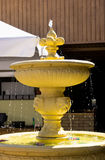 Yellow decorative fountain Royalty Free Stock Photos