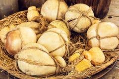 Yellow decorative pumpkins in the wicker basket Stock Photo