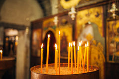 Yellow delicate candles in the church Royalty Free Stock Photography