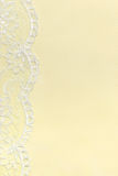 Yellow Delicate satin background with lace border. Stock Photos