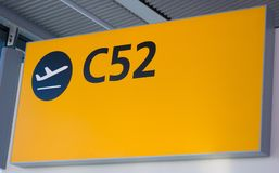 Departure sign, UK. Yellow departure sign in an airport, UK Royalty Free Stock Photos
