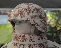 Yellow desert camouflage military helmet. With protection stock photos