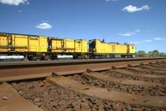 Yellow desert train. Railway line with yellow train in Australian desert Royalty Free Stock Photos