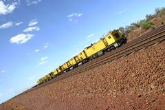 Yellow desert train. Railway line with yellow train in Australian desert Stock Photos