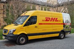 A yellow DHL courier service delivery van Stock Photography