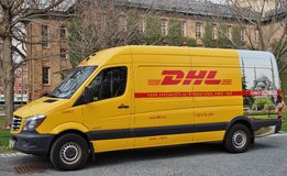 A yellow DHL courier service delivery van Royalty Free Stock Photos