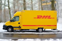Yellow DHL international courier and parcel deliivery service truck in snow stock photography